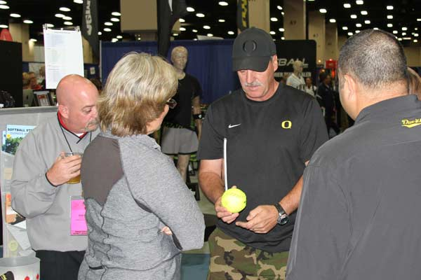 NFCA 2013 Convention San Antonio TX - Cindy taking pitching with Mike White (Oregon)
